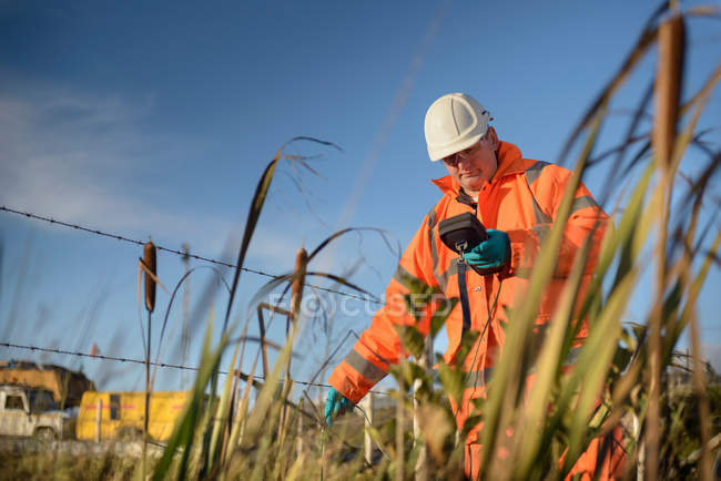 Worker monitoring water at surface coal mine — Stock Photo