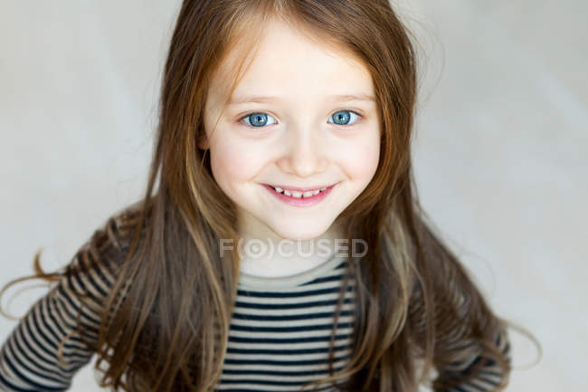 Girl smiling, focus on foreground — Stock Photo