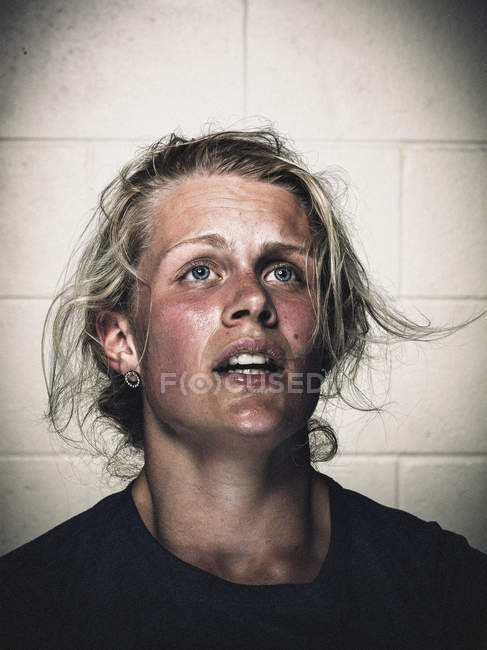 Portrait of exhausted young woman before crossfit training — Stock Photo