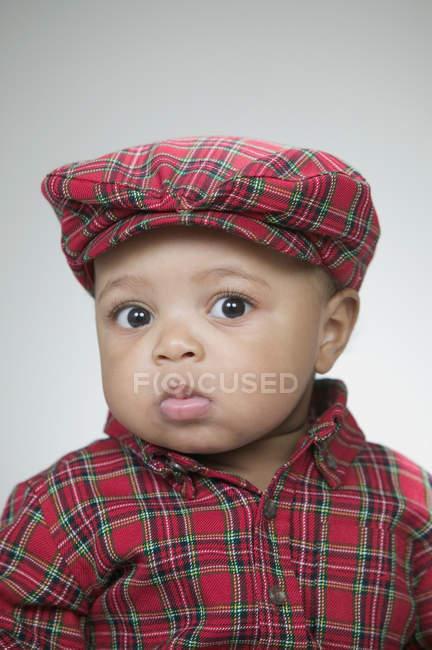 Cute baby wearing a flat cap — Stock Photo