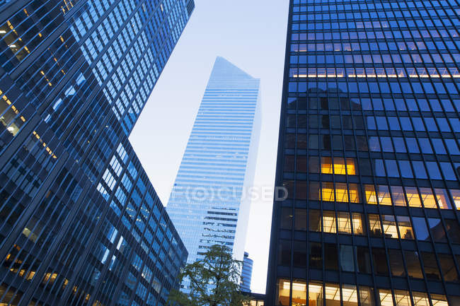 Office buildings with illuminated windows at dusk — Stock Photo