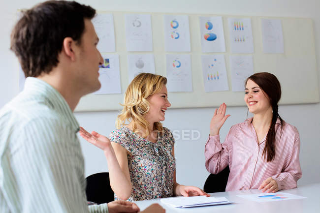 Businesswomen high fiving in office, selective focus — Stock Photo