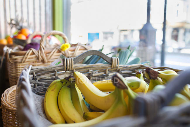 Basket with bananas on market — Stock Photo