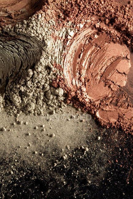 Brown, black and gray cosmetic powder pattern — Stock Photo