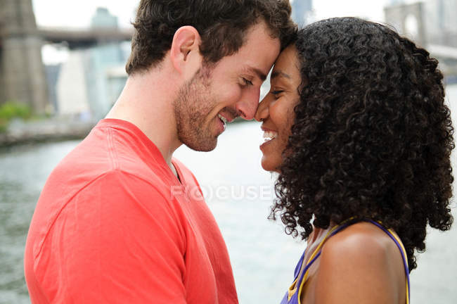 Couple face to face, side view — Stock Photo