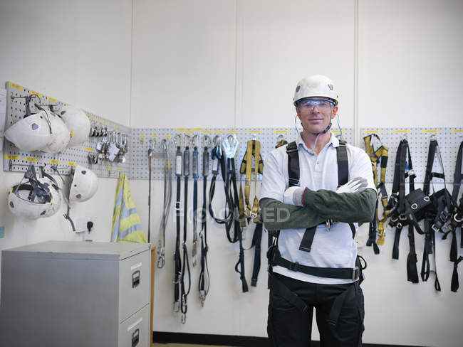 Portrait of car worker wearing health and safety equipment in car factory — Stock Photo