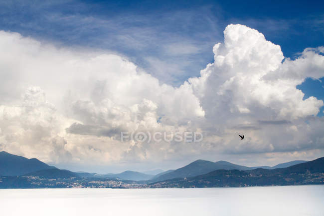 Clouds over snowy landscape — Stock Photo