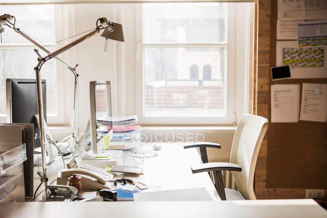 Empty desk in office — Stock Photo