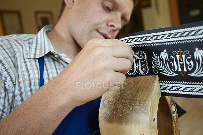 Worker examining weaving in shop — Stock Photo