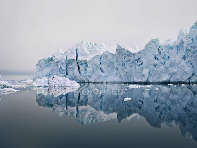 Glacier reflected in still lake — Stock Photo