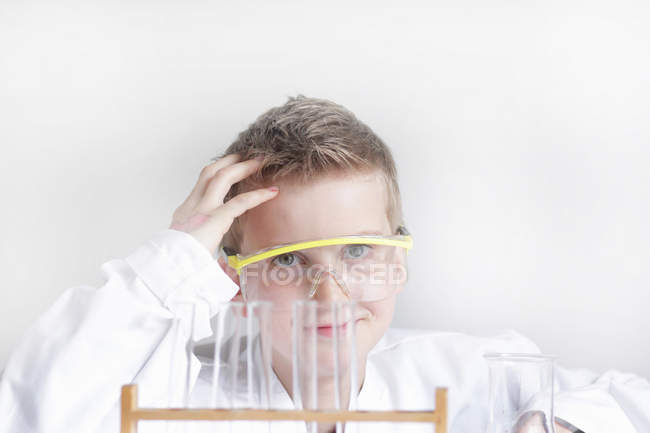 Student wearing safety goggles in lab — Stock Photo