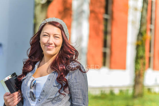 Portrait of adult female college student on campus — Stock Photo