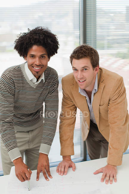 Businessmen smiling in meeting — Stock Photo