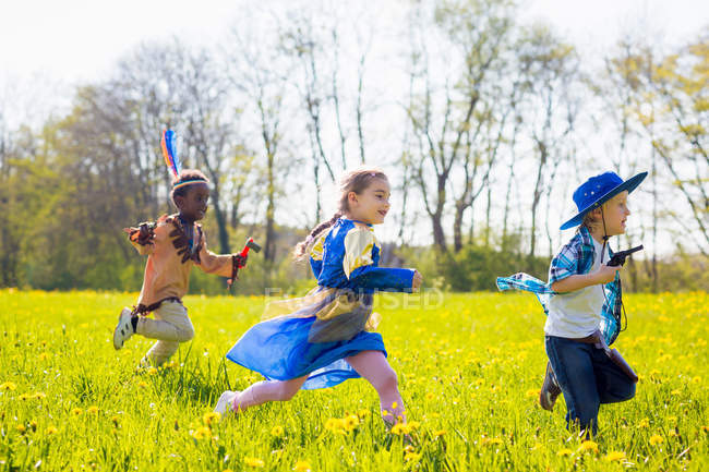 Children playing dress up outdoors — Stock Photo