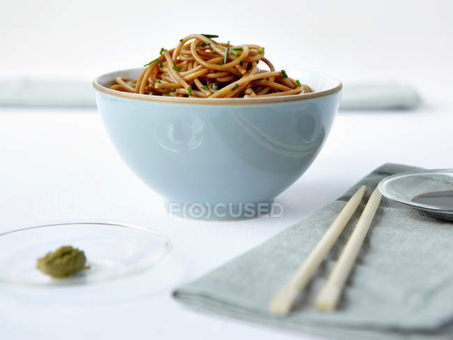 Bowl of noodles with chopsticks — Stock Photo