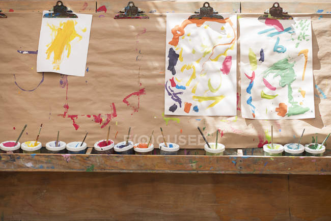 Children paintings, hanging to dry — Stock Photo