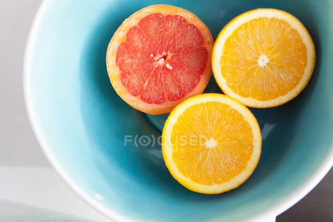 Halved citrus fruits — Stock Photo