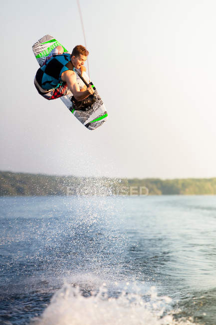 Male wakeboarder in air — Stock Photo