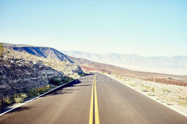 View from straight desert road — Stock Photo
