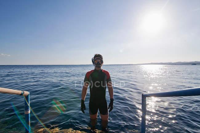 Snorkeler standing in open water — Stock Photo