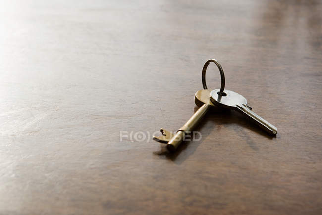 Close Up View Of Keys On Table Stock Photo