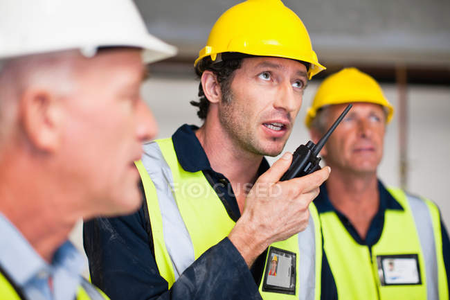 Workers using walkie talkie on site — Stock Photo