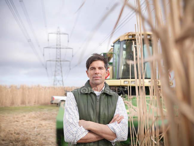 Farmer on biomass farm at harvest time — Stock Photo