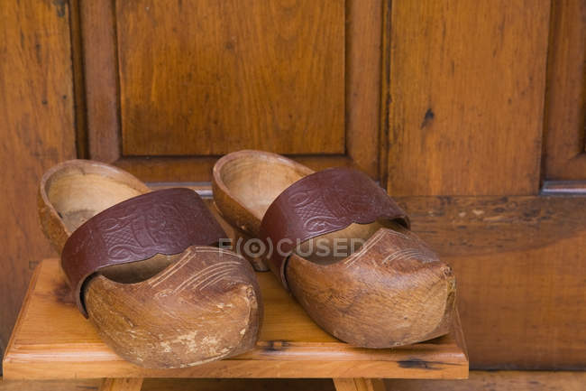 f7c7457883c56 Pair of old vintage Wooden clogs — two objects, nobody - Stock Photo ...