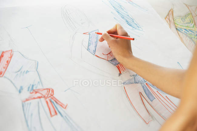 Female hand drawing fashion designs — Stock Photo