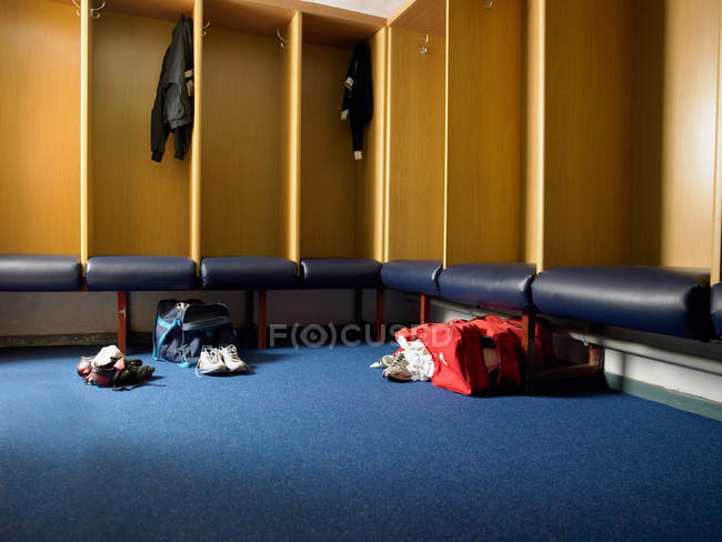 Rugby team changing room with empty ambry and gym bags — Stock Photo