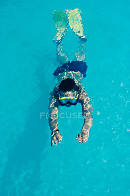 Woman swimming in snorkel and fins — Stock Photo