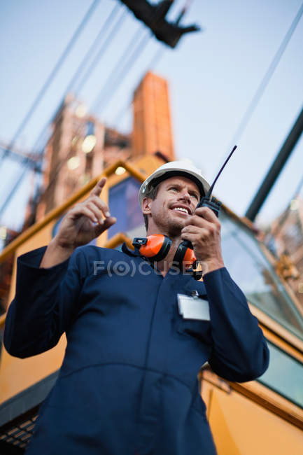 Worker using walkie talkie on site — Stock Photo