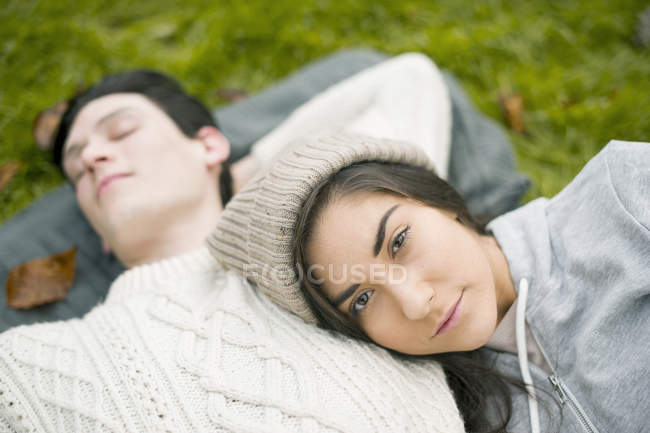 Portrait of young woman resting head on man's chest — Stock Photo