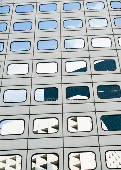 Reflection in modern building facade — Stock Photo