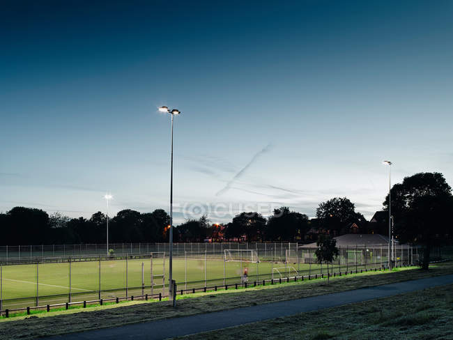 Football pitch at dusk, Manchester, England — Stock Photo