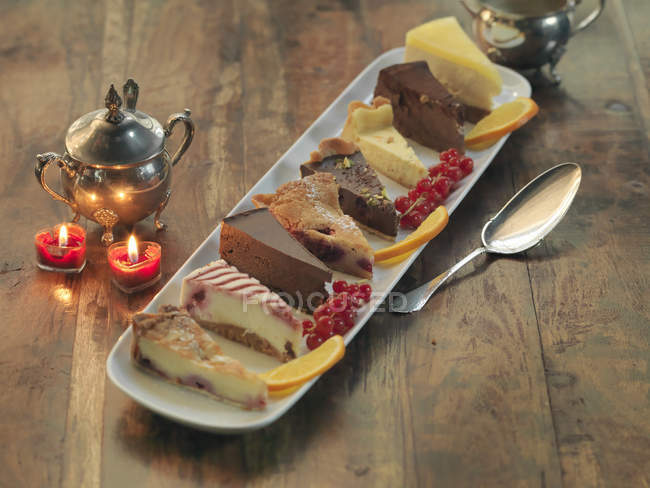 Platter of cakes and tarts amongst festive decorations — Stock Photo