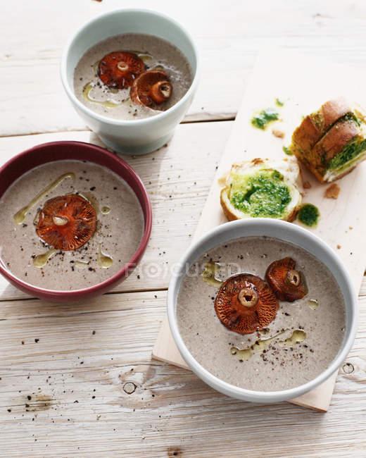 Bowls of mushroom cream soup — Stock Photo