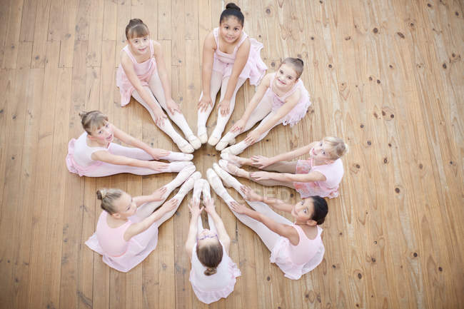 Young ballerinas in circle formation — Stock Photo