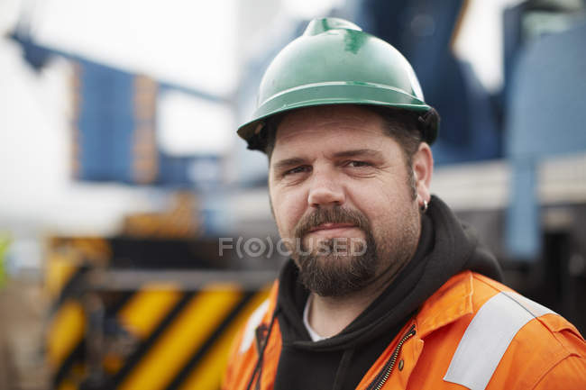 Portrait of mid adult male engineer at wind farm — Stock Photo