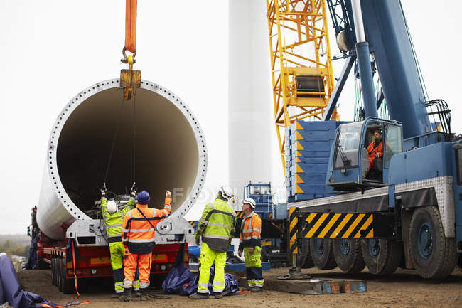 Engineers working on wind turbine construction site — Stock Photo