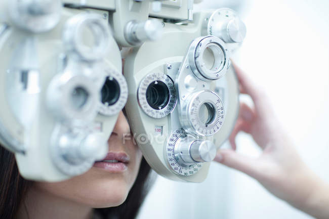 Young woman having eye test — Stock Photo