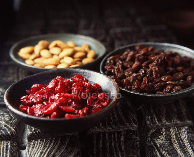 Bowls of dried fruit and nuts, close up — Stock Photo