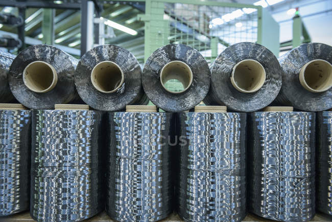 Rows of carbon fibre in carbon fibre factory — Stock Photo