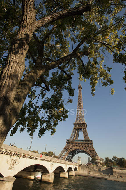 Eiffel Tower seen from over banks of river Seine at Pont d'Iena bridge in Paris, France — Stock Photo