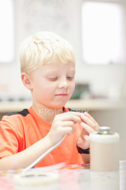 Portrait of Boy making craft object — Stock Photo