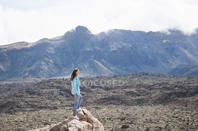 Mid adult woman standing on rock, Teide National Park — Stock Photo