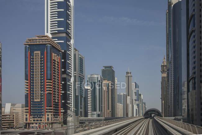Skyscrapers and metro rail tracks under blue sky — Stock Photo