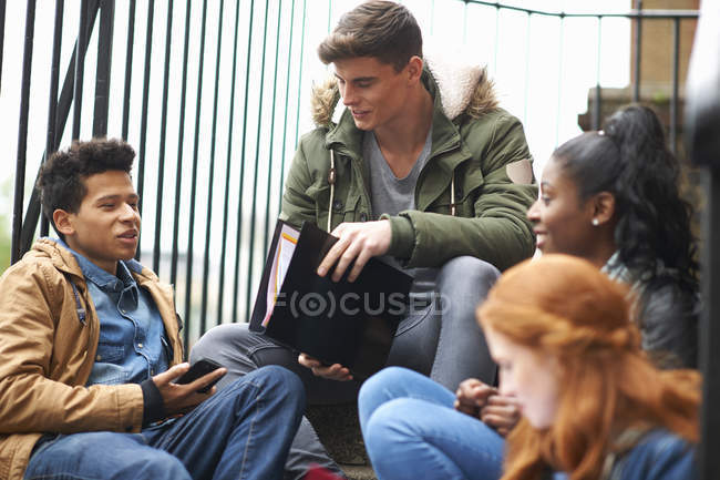Young male and female college students revising on campus — Stock Photo