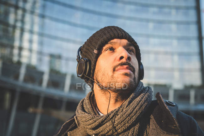 Low angle view of man in headphones looking away — Stock Photo