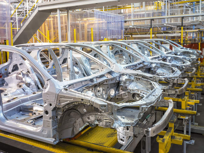 Car bodies on production line in car factory — Stock Photo